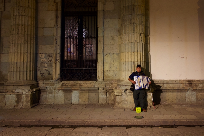 Blind accordion player surviving in his world...