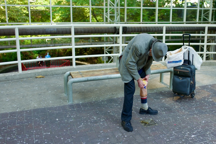 This poor guy has to empty his urine sack in a street drain because of a lack of public washrooms. Vancouver, BC.