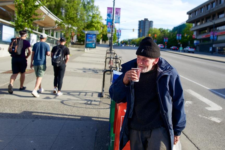 Homeless man enjoying his morning coffee...